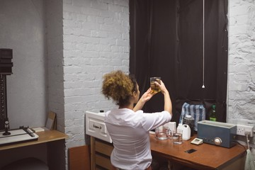 Female photographer checking a chemical in photo studio