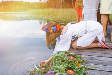 girl lets wreaths on the water