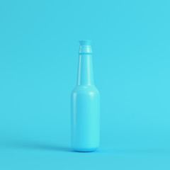Blank bottle with stopper on bright blue background in pastel colors
