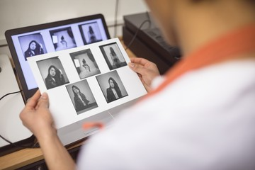 Female photographer developing photos
