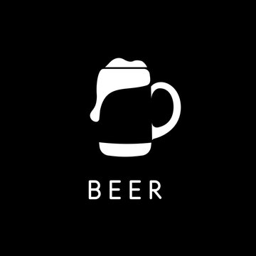 Beer mug with beer, negative space logo template, white silhouette on black background. Vector bar logotype.