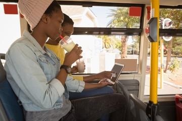 Twins siblings using digital tablet