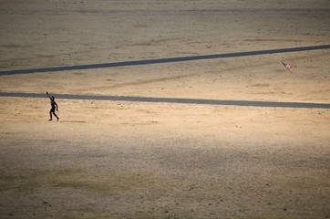A man flies a kite in Greenwich Park