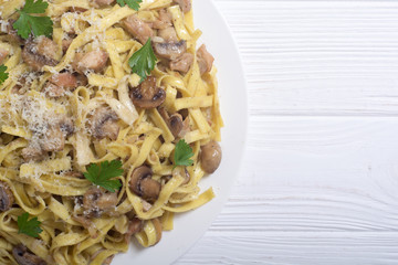 Pasta tagliatelle with chicken meat and mushroom