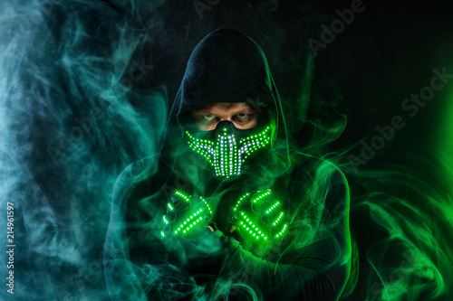 Mysterious Man In Black Wear Neon Mask And Gloves