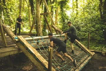 Fit mens training over obstacle course