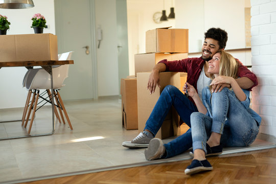 happy couple having fun while moving in