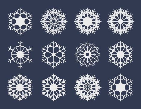 White snowflake icons collection isolated on dark background for your winter design. Vector illustration for abstract snow pattern or snowfall