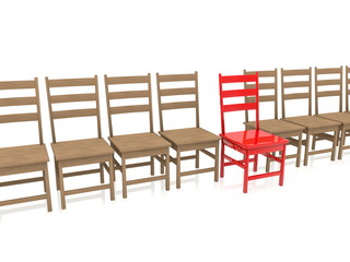 Wooden chairs in row with one red out