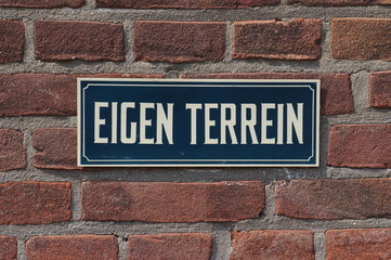 "A Dutch ""private property"" sign (Dutch: Eigen Terrein)."
