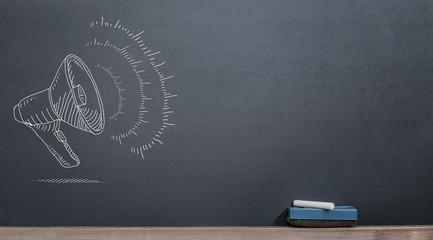 megaphone on the blackboard with chalk