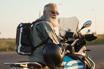 Portrait of a senior man outdoors. Old biker portrait.