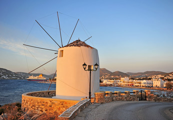 Sunset view of old windmill and Paros old town