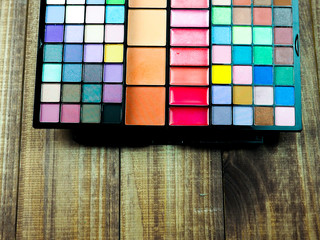 palette cosmetic eye shadow many colors, space, beauty and fashion.