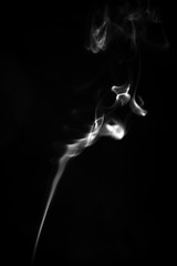 Close up of white smoke on black background. Abstract and texture concept.
