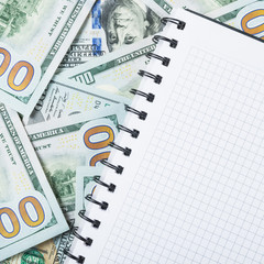 Notebook for notes on money background from one hundred dollars