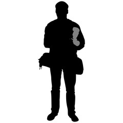 silhouette of a man with camera and flash