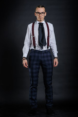 Young handsome boy in white shirt with tie
