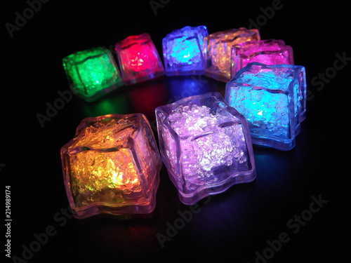 Bright and beautiful colors of different luminous ice cubes on a