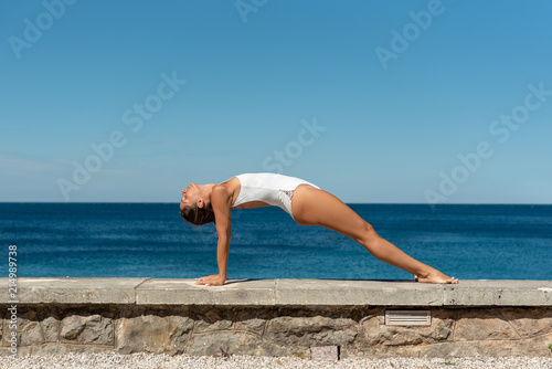 Yoga fitness woman stretching body, doing reverse plank pose