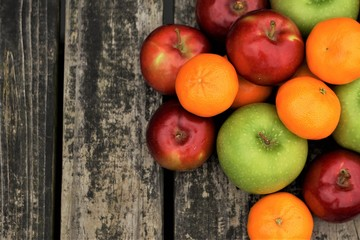 Colorful various kinds of fruit on the old wooden background with space for text, Aumn in GA USA.