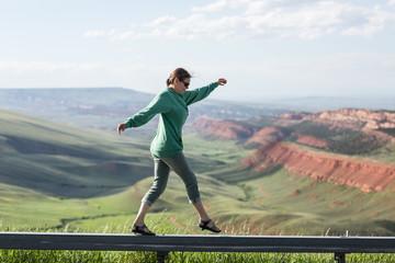 Woman walking along a railing, Lander, Wyoming, America, USA