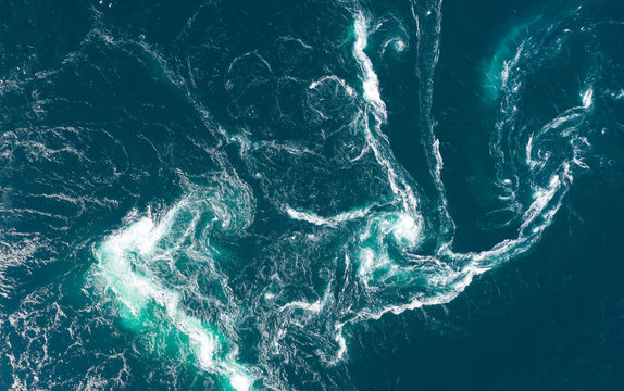 Abstract water currents, rapids and whirlpools in fjord. Saltstraumen, Norway