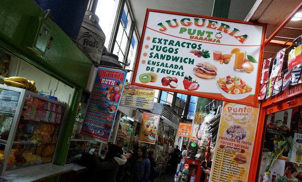 Stands selling fruit juice and sandwiches for breakfast are seen at Surquillo market in Lima