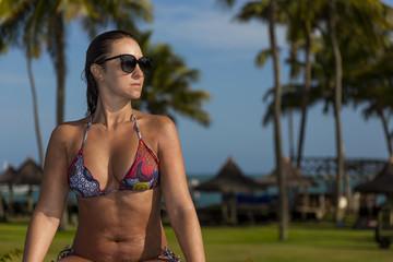 Beautiful brazilian woman enjoying vacation holidays at a pool.