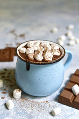 Canvas Prints Chocolate Homemade hot chocolate with mini marshmallow in a blue enamel mug.Rustic style.