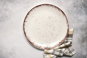 Culinary background with empty plate and napkin.Top view with copy space.