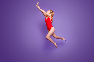 Summer time! People person hobby emotion expressing concept. Full length size studio photo portrait of beautiful excited funny fancy funky lady swimming under water isolated bright purple background