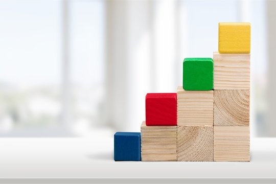 Wooden cubes on white table