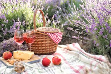 Set for picnic on blanket in lavender field