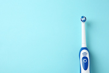 Electric toothbrush on color background. Dental care