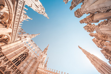 view of Gothic architecture and art on the roof of Milan Cathedral (Duomo di Milano), Italy Wall mural