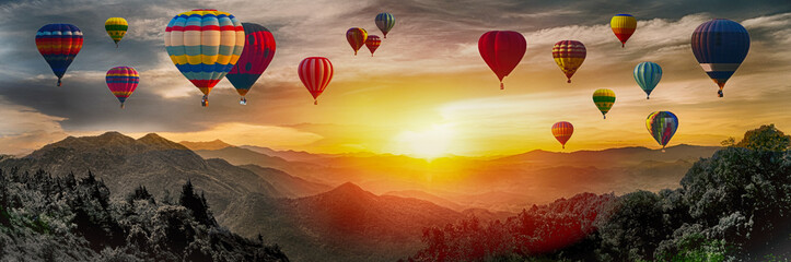 Poster Balloon Dramatic panorama of mountain with hot air balloons at sunset,Thailand.