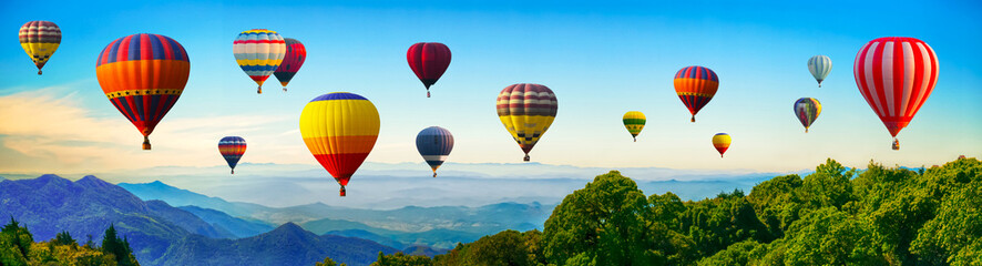 Deurstickers Ballon Panorama of mountain with hot air balloons on morning at Thailand.