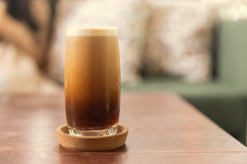Cold brew or Nitro Coffee drink in the glass with bubble foam