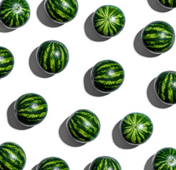 Whole watermelons arranged on a white background