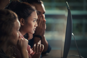 Caucasian and Asian businessmen are constantly watching over the Internet through their computer, feeling stressed and upset.