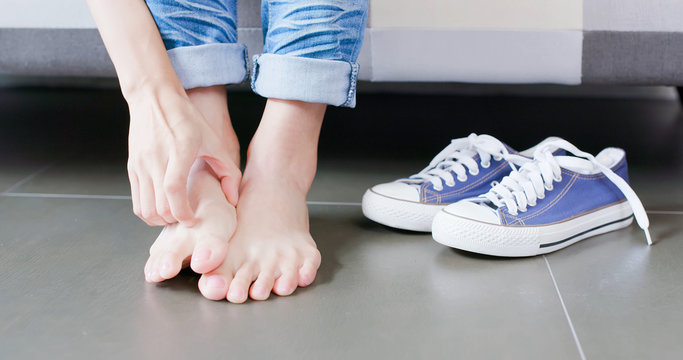 close up woman athlete foot
