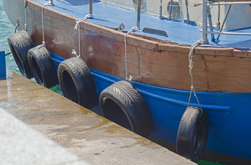 Wooden boat near the pier