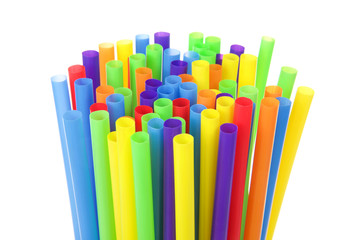 many colorful plastic straws with opening upwards isolated on white background. San Francisco's board of supervisors voted unanimously to join cities such as Vancouver, Berkeley and Seattle in banning