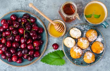 Dessert set on table, gray blue background