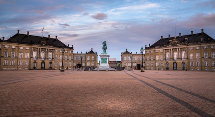 Amalienborg Palace in Copenhagen, Denmark. Surrounding the palace square with its statue of King Frederik V from 1771, Amalienborg is made up of four identical buildings.