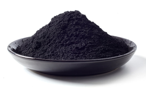 Dish heaped with food grade pulverised charcoal