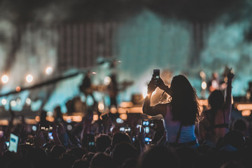 Woman taking shot of stage