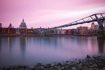 Long exposure, Millennium bridge and St Paul's cathedral at sunset in London
