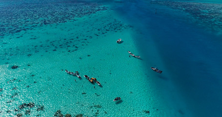 boats in a lagoon in French Polynesia, in aerial view